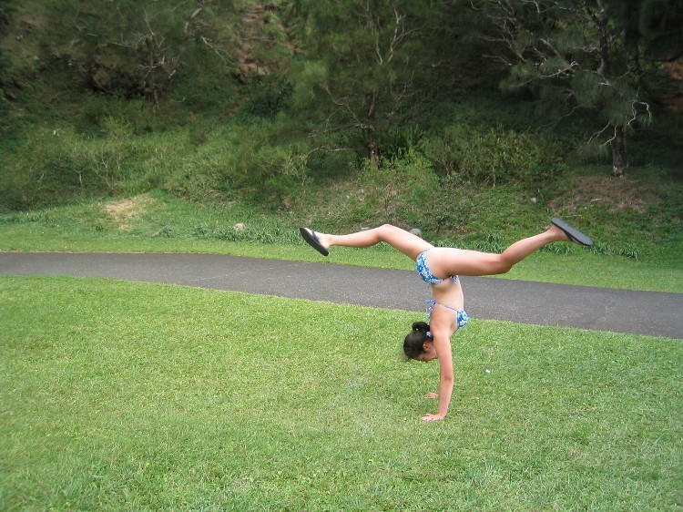 "From the subgenre of ""Hawaiian handstand photos"" -- this one's at Nuuanu Pali Lookout on Oahu."