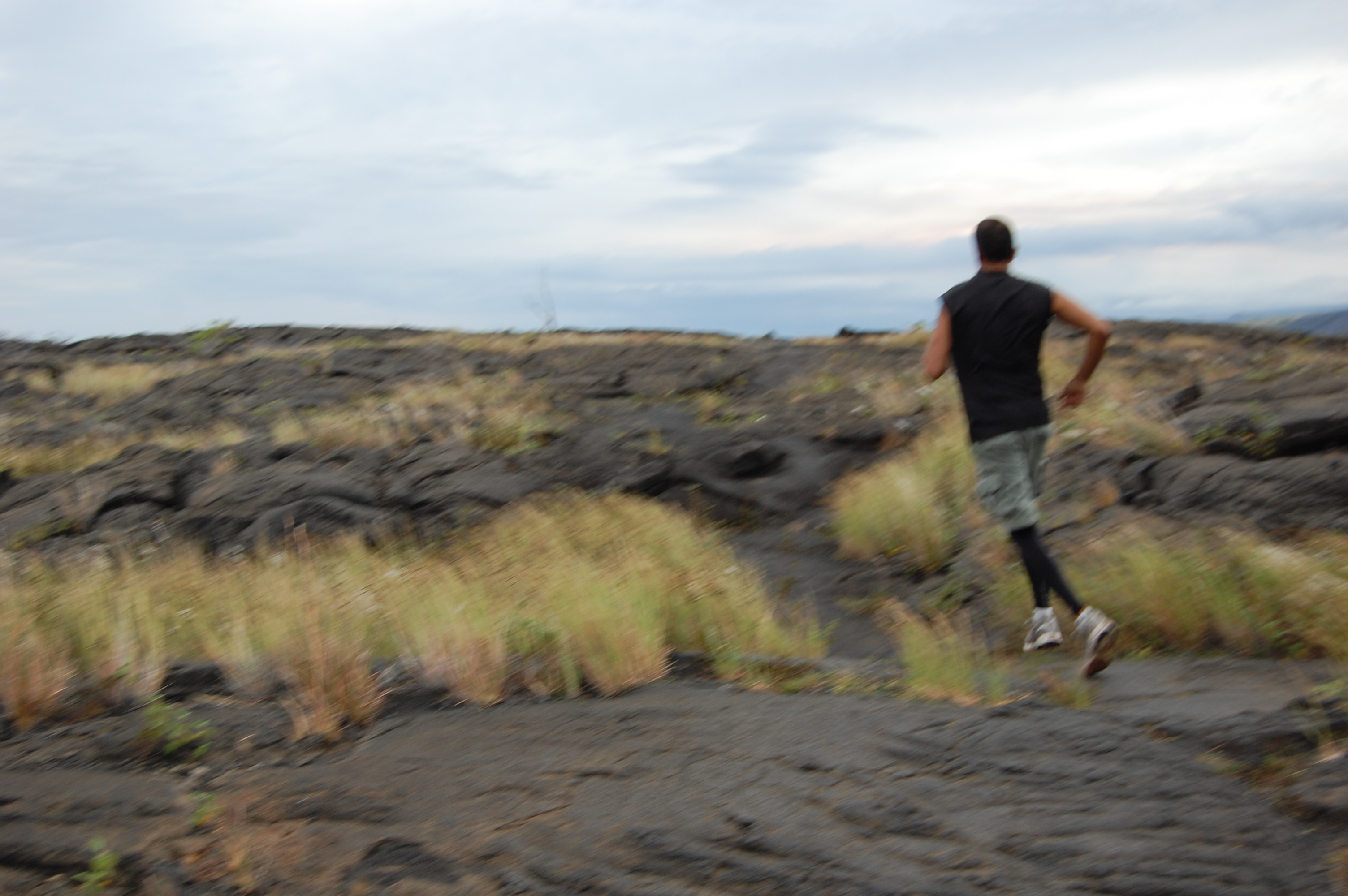 Boyfriend running the trail -- i.e., a volcanic hike in Kilauea National Park in Hawaii. (Not intended to be jogged, in case you were wondering.)
