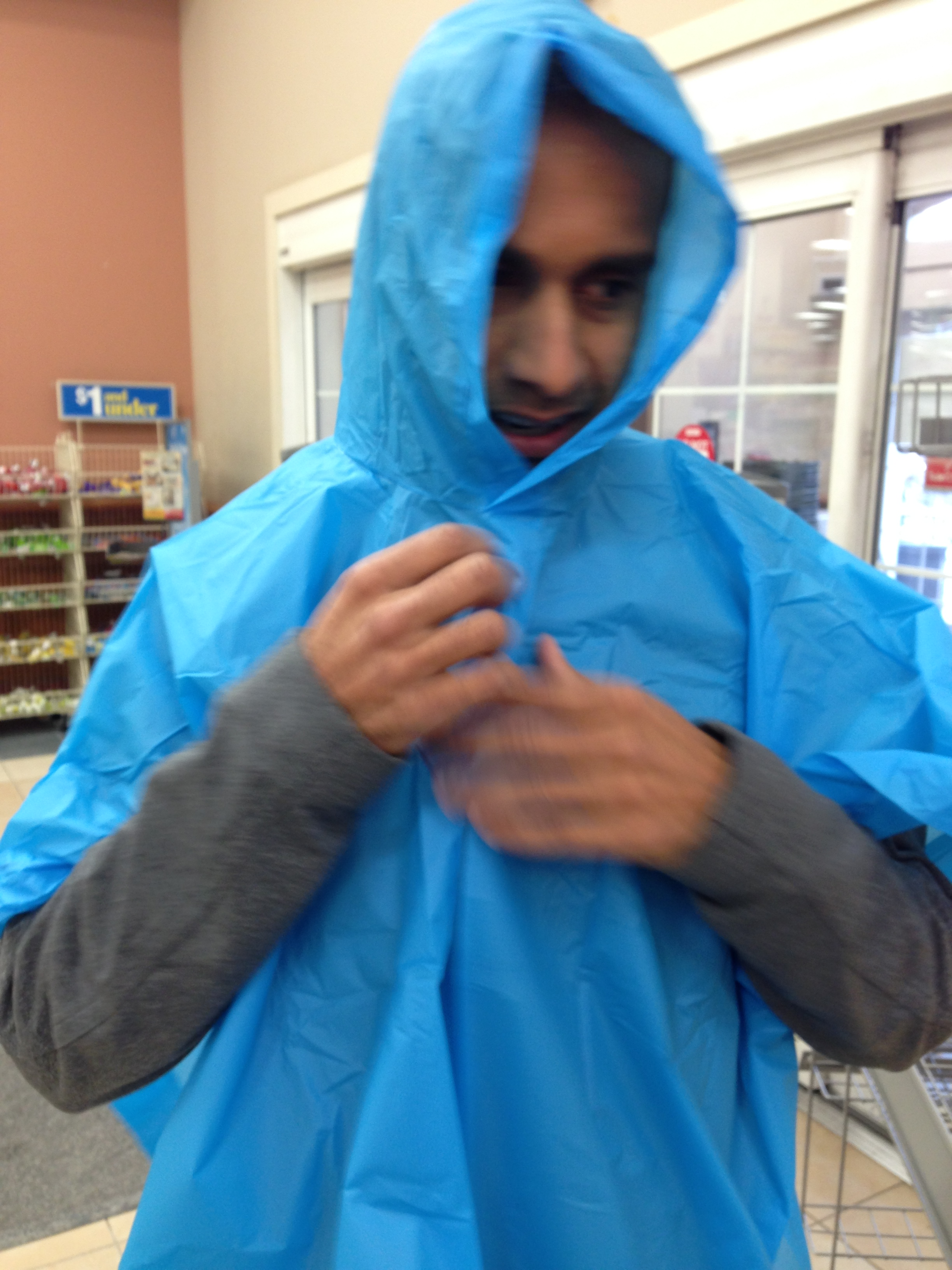 By the grace of Mike Haddad (chief meteorologist of Storm Watch 9 team), we slipped back to CA shortly before the brutality of winter storm Hercules. We did, however, have one rather diluvial day, for which this child-sized poncho was bought.