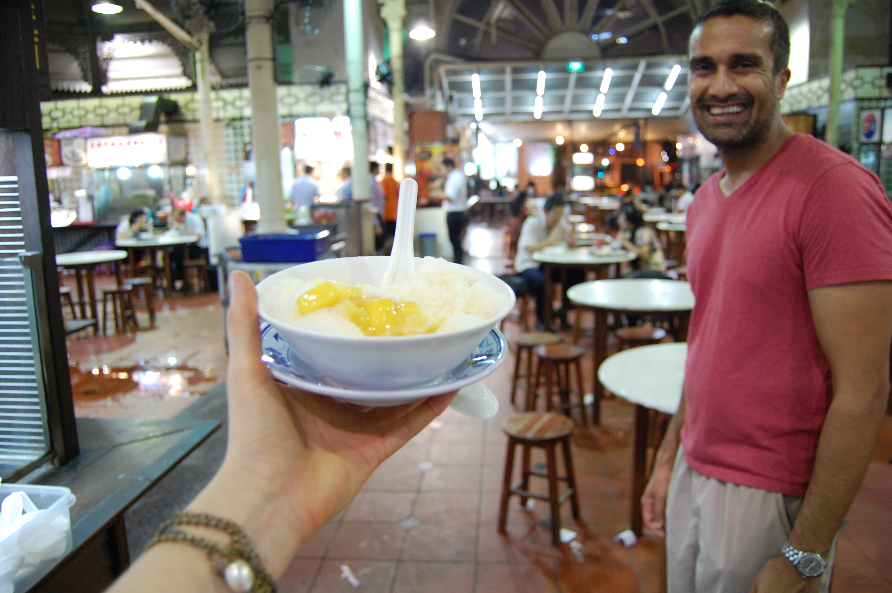 ... to the hawker centres of Singapore ...