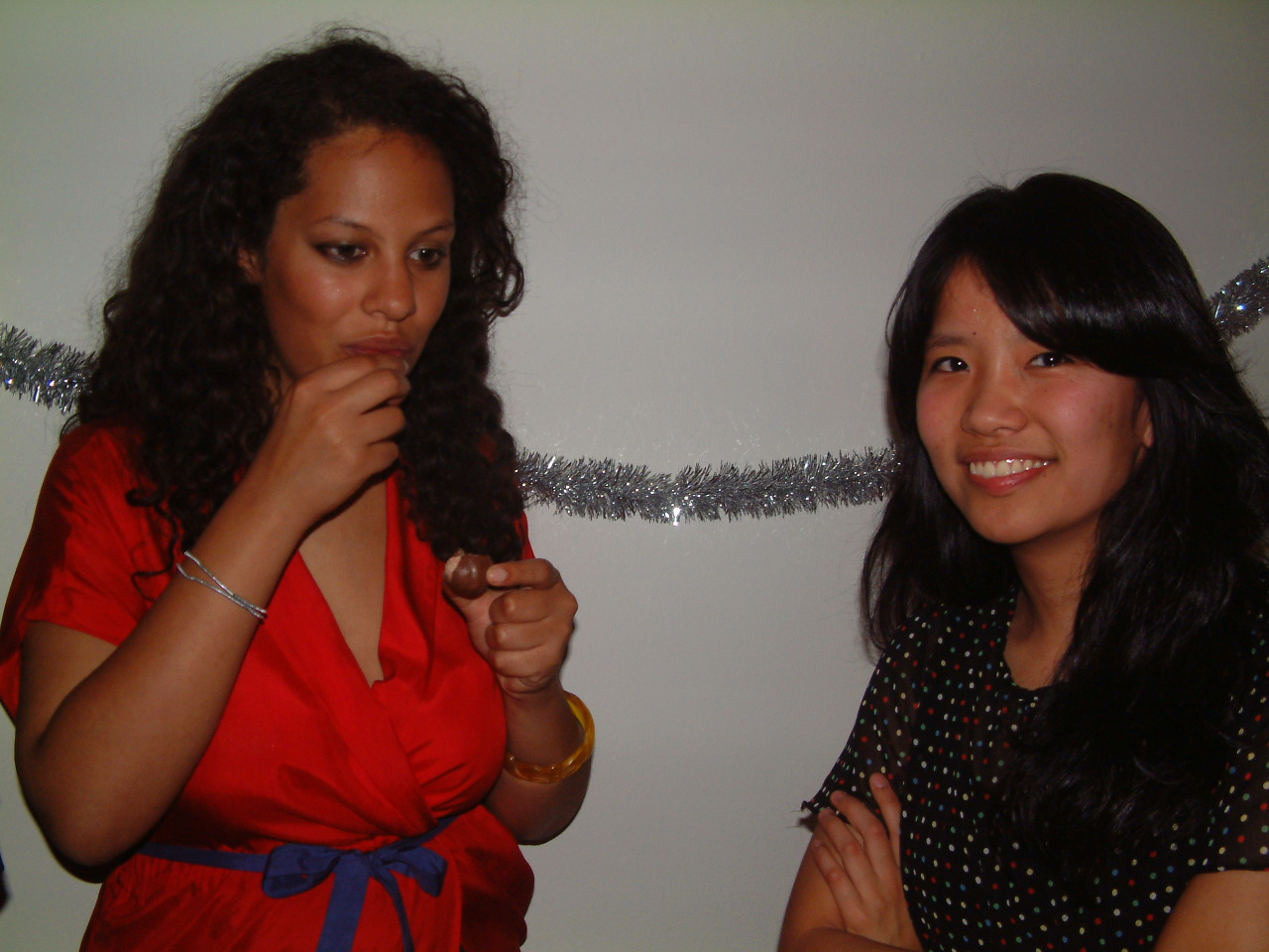 Another friend, Liz (left), and Lauren at an awkward house party, same year.