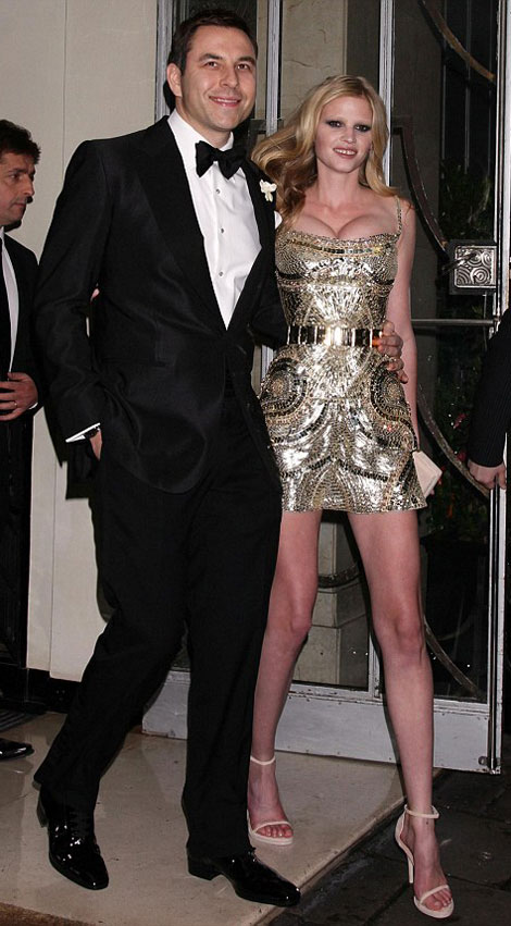 It seems a bridge too far to throw the hasty dressing room iPhone photos of the dress I chose up here, so I'll include some of my favorite celebrity wedding dresses. First up: the Givenchy dress Lara Stone wore to her reception. Daring!