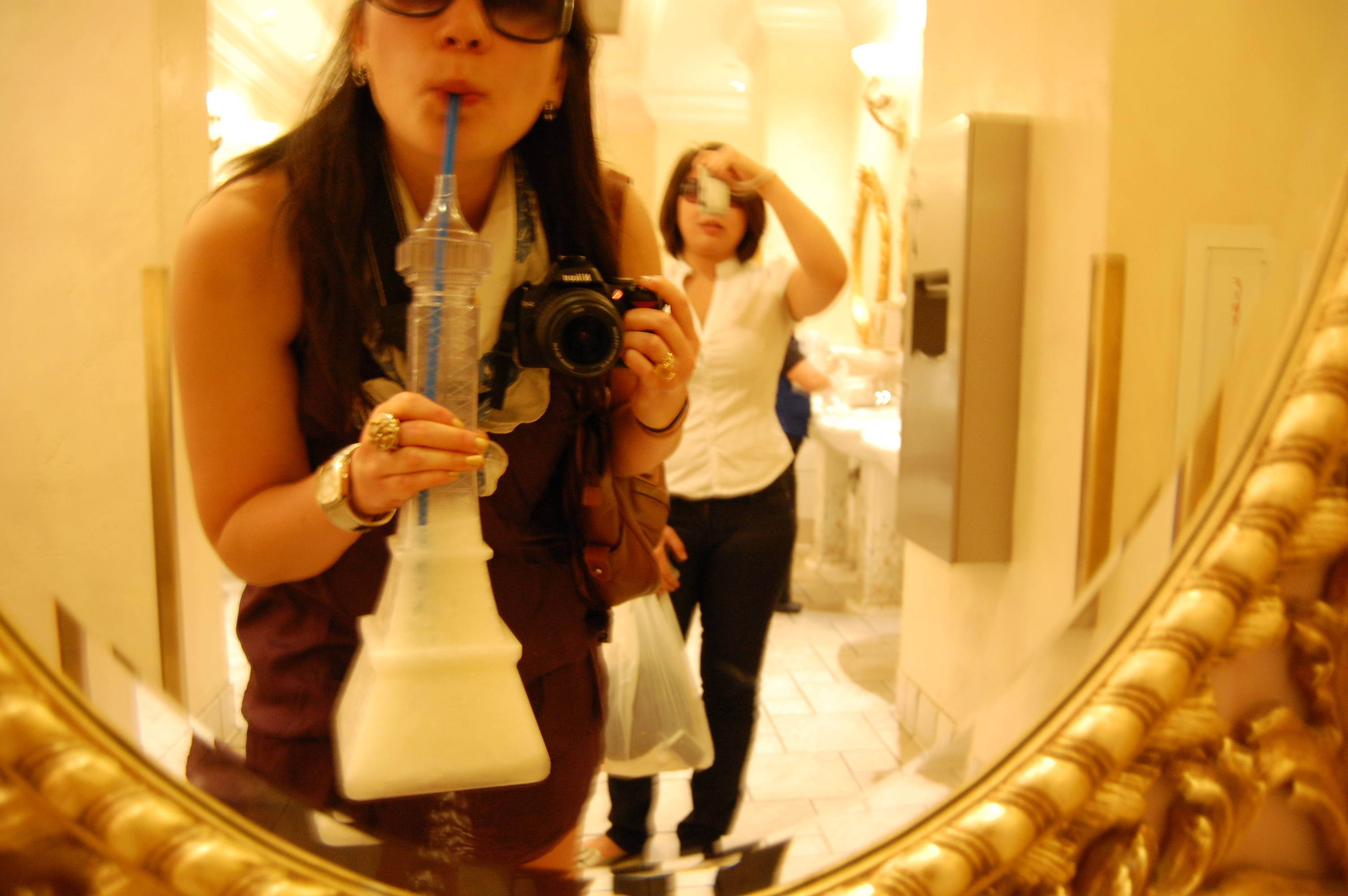 Las Vegas 2009, with friend. Sinking our teeth (and our livers) into the role of debauched day drinkers/Dionysian daredevils