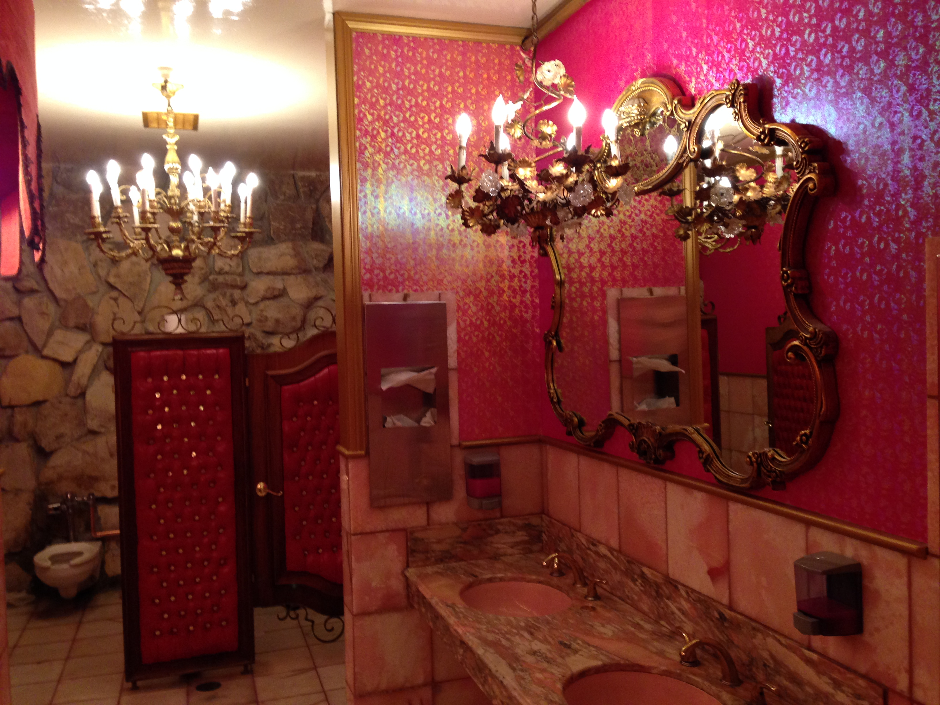 The women's bathroom was done to the exacting specifications of ... Liberace?