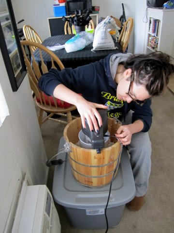 Oh look! Here I am making sour cherry yogurt for my sister 4 years ago. The coke bottle glasses. The college-issue sweats. The particle-board apartment. Surely you will agree this is the height of glamour.