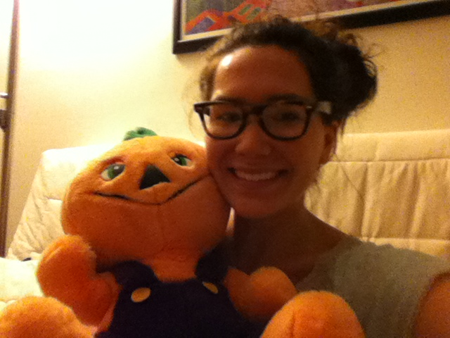 With my friend -- my old roommate's beloved stuffed anthropomorphized pumpkin from childhood