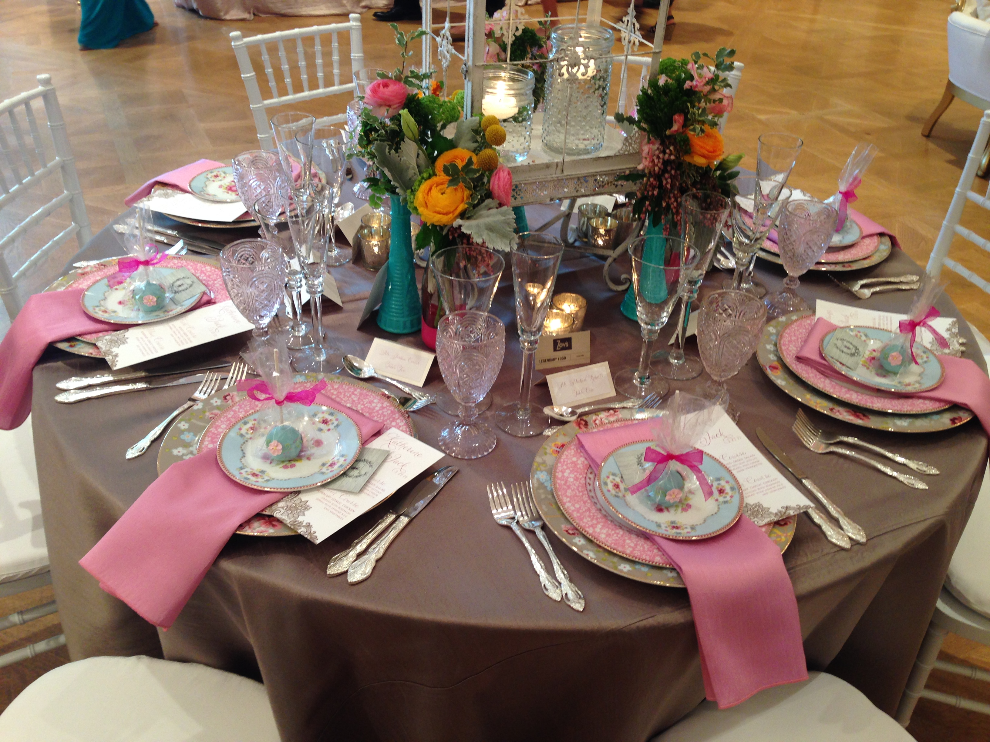 We won't be paying for these elaborate settings and centerpieces. Upon beginning to plan a wedding, you finally learn that little touches like these can quickly act as a budget multiplier!