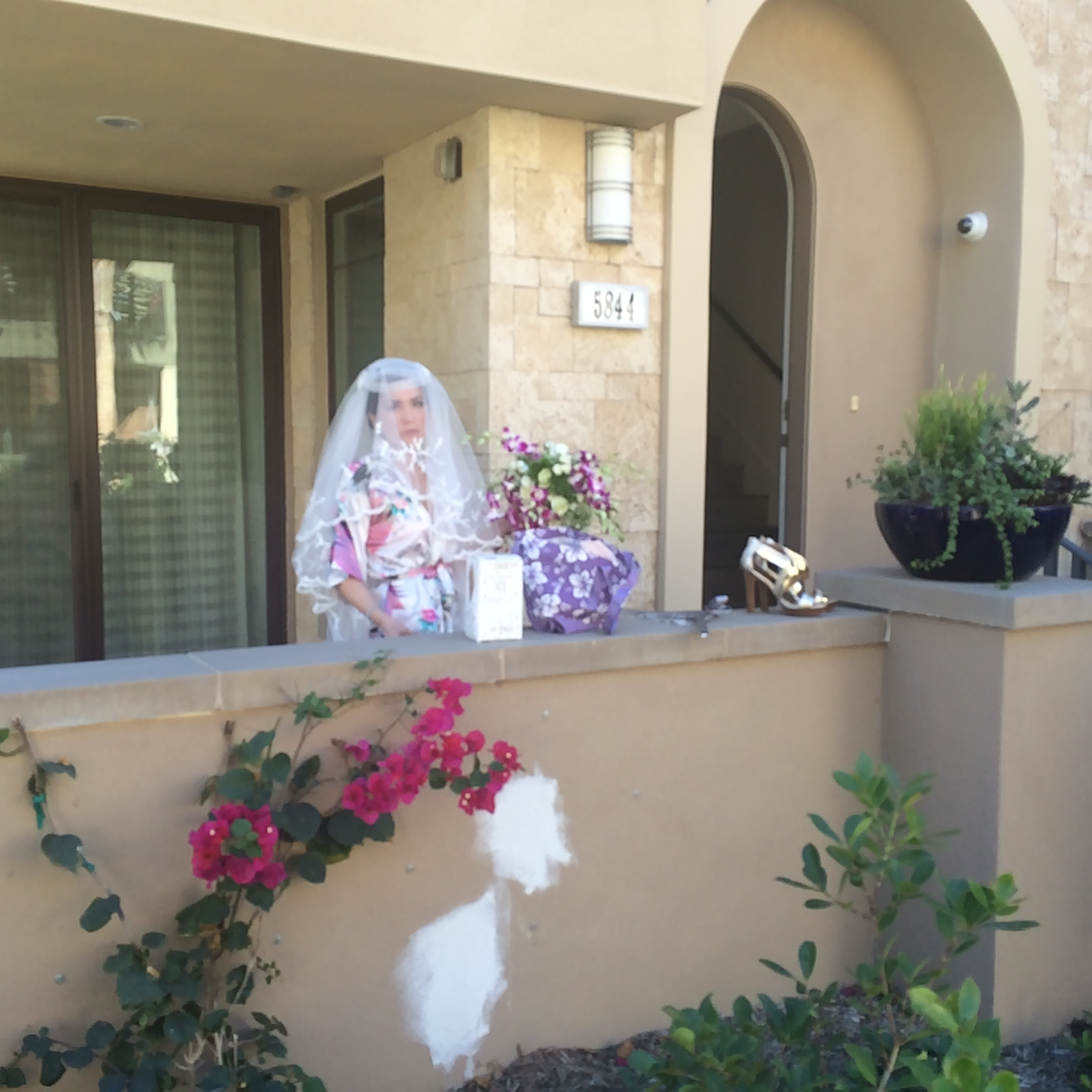 """This one says: """"I'm all ready to get married! I spent hours and $$$ on this look. Yet I didn't spend minutes or ¢¢¢ on fixing the big discolored stucco patches outside our house."""""""