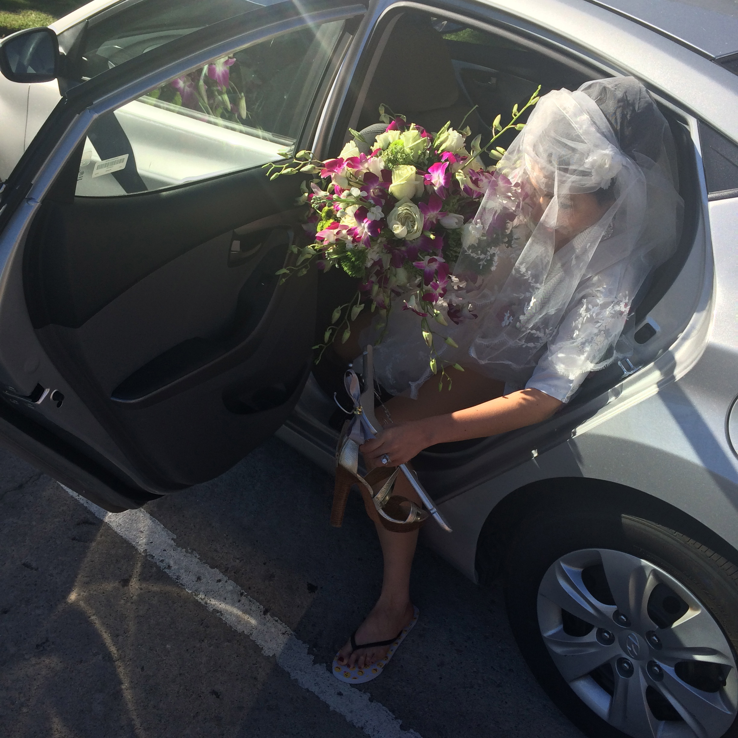 """This one says: """"I didn't think through the transport issues associated with this gargantuan homemade cascade bouquet. Someone will figure it out for me!"""""""